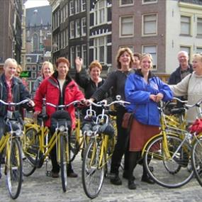 Group is enjoying from bike tour in Amsterdam