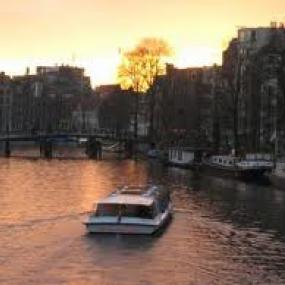 Enjoy Amsterdam on river which surround city.